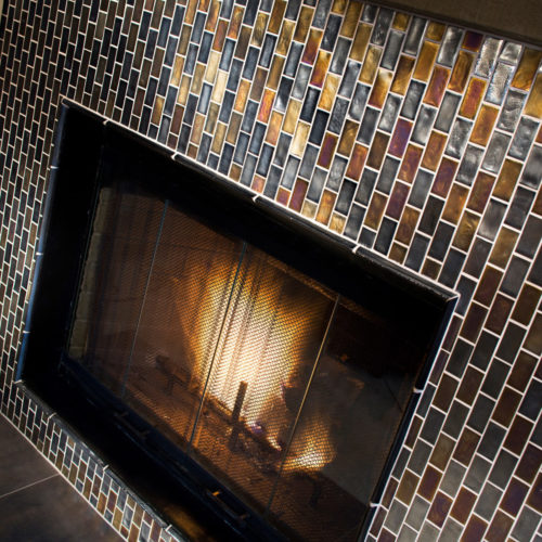 Fireplace black gold subway brick mosaic muse